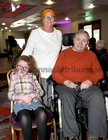 Claire and John Brennan, Claddagh, with their granddaughter Saoirse Gallen at Merlin Park Hospital Tea Dance at the Clayton Hotel.