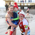 Shirley Potter with her nephew Rian Sheridan and his grandaunt Bernie Rogers, Carnmore, after their Christmas Day swim at Blackrock.