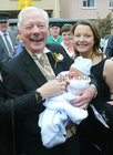 Gay Byrne with his six day old grandson Cian and his daughter Suzy, at the marriage of his daughter Crona to Philip Carney at Spiddal Church.  28 September 2004