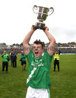Deasún Ó Conghaile lifts the cup after Moycullen won the Senior Football Championship final at Pearse Stadium last Sunday.<br />