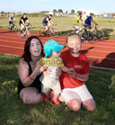 Kayleigh (left) and Jodie Mulhall and cousin Benjamin Quirke (18 months) at the Westside running track to watch Stevo Timothy during his Tour De Westside charity cycle at the weekend. Stevo, who has incomplete paraplegia after a motorbike accident in 2015, has raised over €55,000 through his GoFundMe page after he completed the cycle.