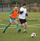 Rafael Bisceglia and Ronnie Crowe in action during the annual COPE Galway charity match.<br /> <br />