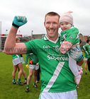 Marc Ó Loideáin celebrates with his 6 month old daughter Sarah after Moycullen won the Senior Football Championship final at Pearse Stadium last Sunday.<br />