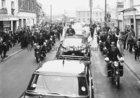 President John F Kennedy visited Galway in June 1963, five months before his assassination. <br /> <br /> He landed in a helicopter at the Sportsground in College Road where he was greeted by Mayor of Galway, Paddy Ryan. <br /> <br /> They proceeded by motorcade to Eyre Square where the President made a speech and was conferred with the freedom of the City. <br /> <br /> The motorcade then went through the town to Salthill where the President was taken by helicopter from the car park beside Seapoint to Limerick.<br /> <br /> The Motorcade on Forster Street