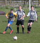 Loughrea v Galway Hibs at Bohermore.<br /> Jamie Daniels, Loughrea, and Keith Ward and Eoin Higgins, Galway Hibernians