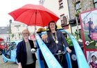 <br /> Sheltering from the rain.... Sinead Ni Mhainnin, holds an umbrella over Cllr Eileen Mannion, Mayor of County Galway, at the launch of Galways Anti Gum LItter  Awareness Programme, at the Square Clifden