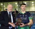 Oughterard v The Neale Connacht Intermediate Cup final at MacHale Park, Castlebar<br /> Gerry McGovern, Connacht GAA President, presents Oughterard's Matthew Tierney with the Man of the Match award.