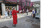 Galway Town Crier Liam Silke out on the city centre streets on Monday welcoming back shoppers and thanking staff and business owners, who have been able to reopen, after the easing of Covid-19 restrictions.