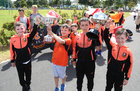 "Young members of Corrib Rangers FC proudly display trophies won by the club as they take part in ""The Sky's the Limit"", the Westside Arts Festival parade."