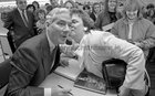Gay Byrne receives a kiss from Lilly Hughes from Renmore while he was signing copies of his book 'The Time of My Life' in the Eason Bookshop in Shop Street in October 1989.