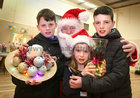 James, Ellen and Evan Irwin from Mervue with Santa at the Ballybane Christmas Fair in the Ballybane Community Centre last Saturday.