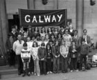 Galway City children who won medals in the finals of the Community Games in Dublin in September 1973. Front (from left): Brian Long, Brid Manifold, Peter Prendergast, Irene Geary, Nessa Kennedy, Pamela Robinson, Mary Curran, Michael Tierney, Michael Langan. Second row (from left): Walter Hegarty (Chess team manager), Mary Arrigan, Siobhan Finn, Deirdre Desmond, Valerie Small, Dorothy Rabbitte, Fiona Sweeney, Kathleen Hume, Michael Roche (Swimming team manager), Adrian Ryder (Judo team manager), Liam Kavanagh (Athletics team manager). Back row (from left): Francis Lovett, John Harhen, Margaret Hickey, Shane Toolan, Deborah Evers, Margaret McNeela, Bernadette Mahon, Mairead Manifold, Collette Lardner, Jimmy Lovett, Mary Evers, Mrs. C. Cunningham (Swimming team manager).