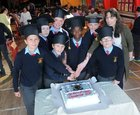 <br /> Cutting a cake... Filip Mateuszuk, Modestas Rimkis, Kyle O Kennedy, Iggy Birmingham-Carey, Michael Okocha, Conaill Cunningham, Rory Toohey, Luka Peikrishivili and Marian Barrett, School Principal, at the graduation  at St. Patricks National School Lombard Street.
