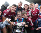 Galway captain Damien Comer beside his first cousin Conor Hannon from Dunmore during the Galway team celebrations at Dr Hyde Park in Roscommon last Sunday.