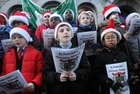 <br /> Pupils singing at the St. Patricks National School Carol Singing on Shop Street.