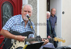John Jordan and Joe Keating look on as Paul Grealish performs at St Brigits Terrace, Prospect Hill, during Covid-19.