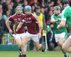 Galway v Limerick Allianz Hurling League semi-final in Limerick.<br /> Galway's Johnny Coen and Cathal Mannion and Limerick's Alan Dempsey