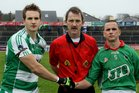 Referee, Frank Kinneen, with captains, Chris O'Toole and Kevin Brady, before the drawn County Intermediate Football Championship Final at Pearse Stadium.