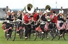 The Crescendo Cycling Band from Holland performing for the Leukaemia Trust during half time at the Connacht Senior Rugby Cup final at the Sportsground.  10/5/'98<br /> One of the photographs from an exhibition of of cyclists in Galway City and County from over the years on display in city centre shop front windows as part of Galway Bike Week.<br /> <br />