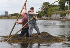 Competitors give it stick as they approach the finish line in the Cimín Race (Seaweed Race) at the Cruinniu na mBad Festival in Kinvara at the weekend.