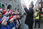 <br /> Cllr Neil Mc Nelis, Mayor of Galway conducts the choir at the St. Patricks National School Carol Singing on Shop Street.