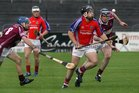 <br />  Clarinbridge's, Shane Burke and Mark Kerins,<br />  and<br />  St. Thomas, Donal Cooney,<br />  during the Senior Hurling Championship at Athenry.<br />