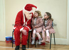 Santa Claus chatting with sisters Lacey Lee and Shianne Sweeney from Ballybane at the Ballybane Christmas Fair in the local Community Centre last Saturday. Lacey Lee was celebrating her 4th birthday with Shianne (6) at the fair when they met Santa.