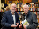 Dave O'Connell, Group Editor of the Connacht Tribune, with Padraic McCormack at the launch of his book 'Beneath the Silence' in Charlie Byrne's Bookshop.