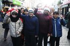 <br /> Pupils at the St. Patricks National School Carol Singing on Shop Street.