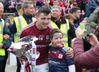 Galway captain Damien Comer poses for a photograph with a young supporters after he was presented with the J J Nestor Cup at Dr Hyde Park.
