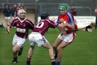 Clarinbridge's, Paul Coen and Eanna Murphy,<br />  and<br />  St. Thomas, David Burke,<br />  during the Senior Hurling Championship at Athenry.<br />