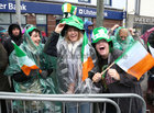 Happy faces as the rain falls down at the St Patrick's Day Parade at Eyre Square